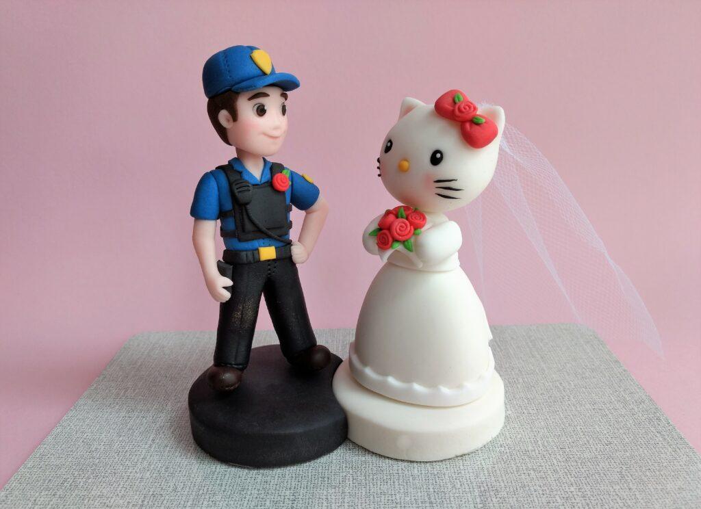 Tortenfiguren Hochzeit Polizist und Hello Kitty