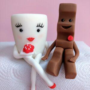 Schoki und Milky Tortenfiguren für Hochzeitstorte